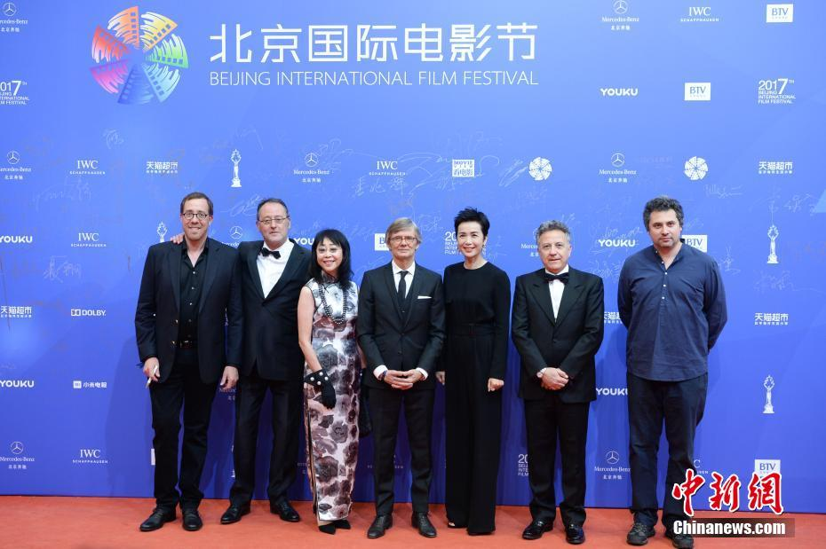 Jury members for the Tiantan Awards Robert Minkoff, Jean Reno, Mabel Cheung, Bille August, Jiang Wenli, Paolo Del Brocco and Radu Jude on the red carpet for the Beijing International Film Festival opening ceremony on April 16, 2017.