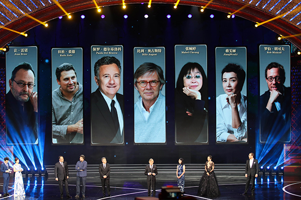 Jury members for the Tiantan Awards; Jean Reno, Radu Jude, Paolo Del Brocco, Bille August, Mabel Cheung, Jiang Wenli and Robert Minkoff at the Beijing International Film Festival closing ceremony on April 23, 2017.