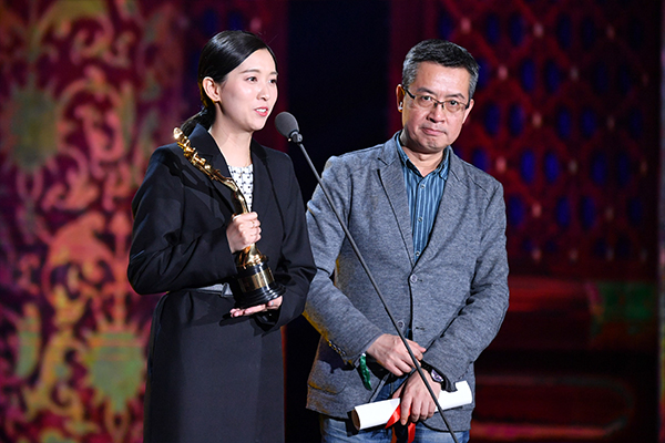 Chinese screenwriters Huang Shi (left) and Mei Feng (right) shared Best Screenplay for their work Mr. No Problem.