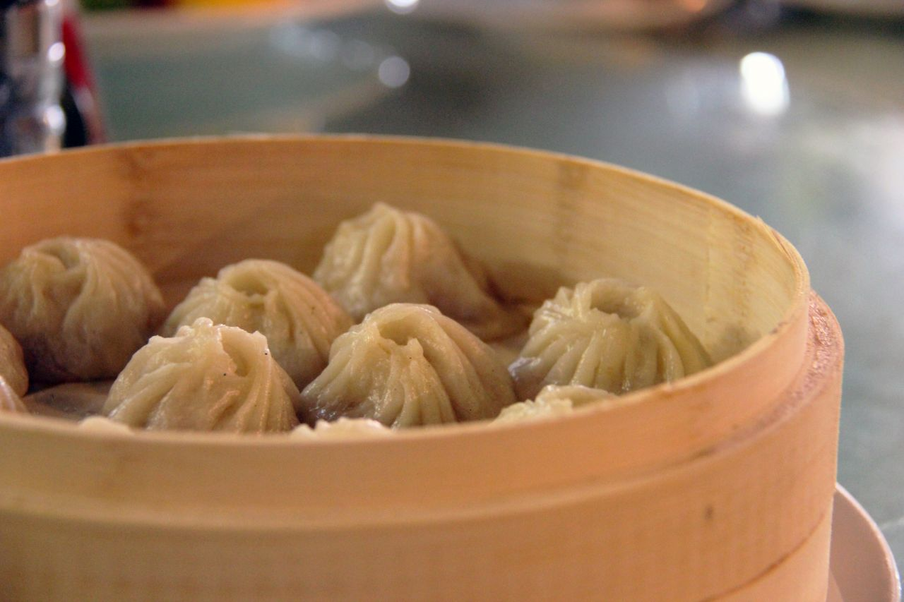 Steamed dumplings with pork. The Hangzhou version of the beloved dim sum dish bursts with subtle flavours, when you sink your teeth into it. In Chinese, they are called 杭州小笼 (Hangzhou xiaolong).
