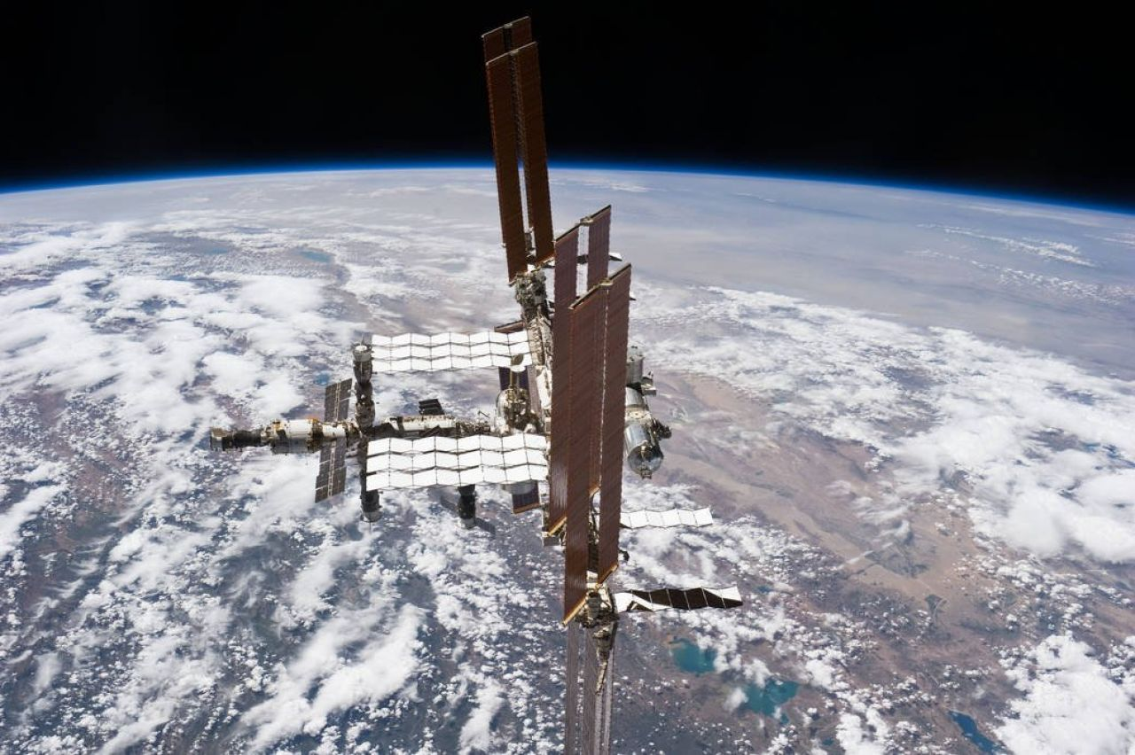 The International Space Station orbiting above the Earth.