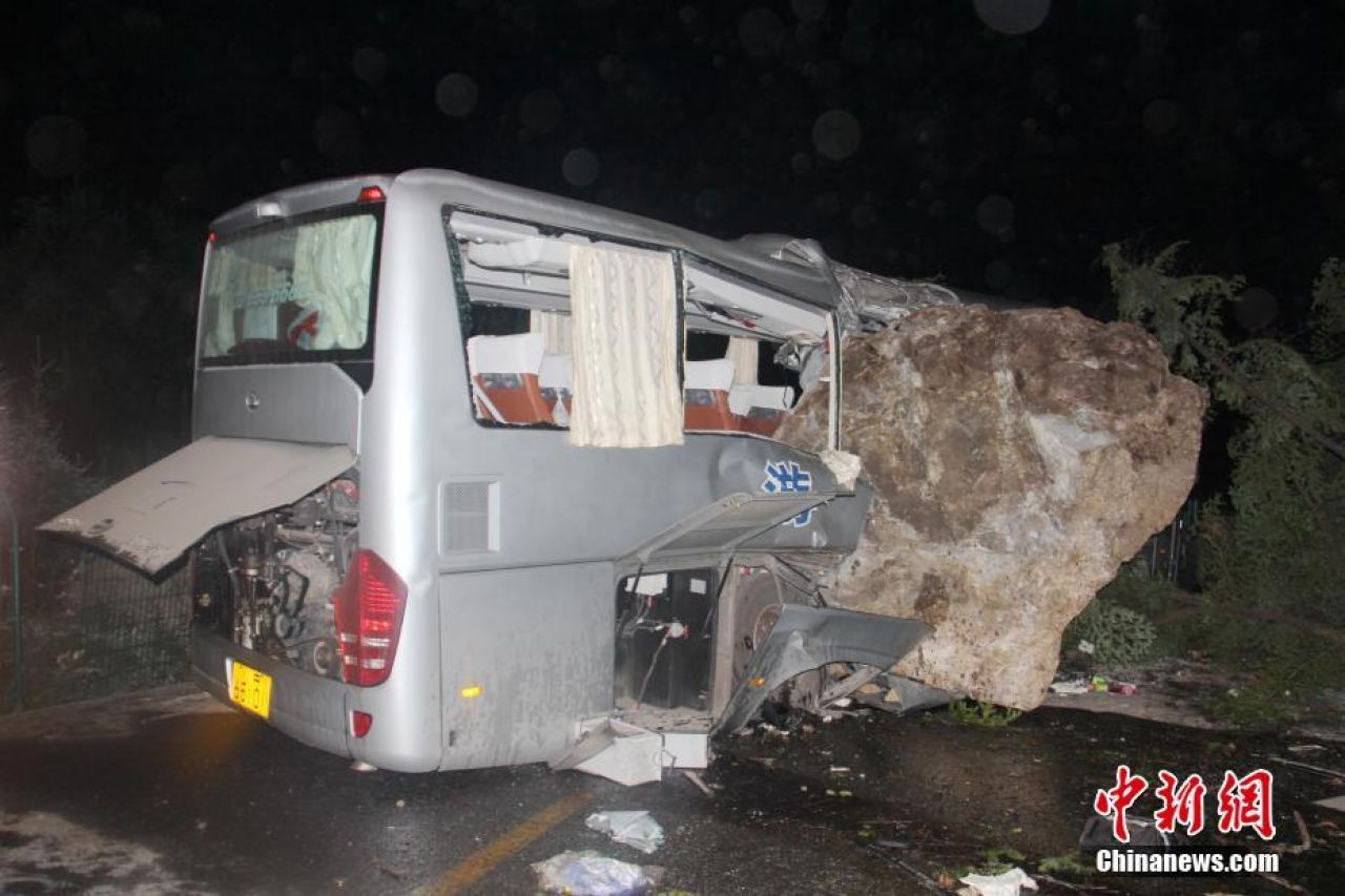 A bus damaged by the falling rocks due to the Jiuzhaigou Earthquake.