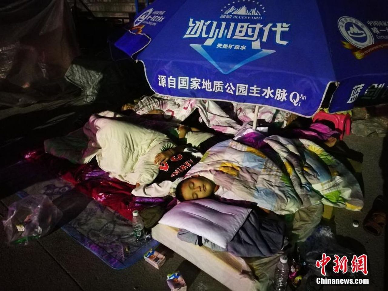 Jiuzhaigou residents sleeping outdoors to avoid the aftershocks.