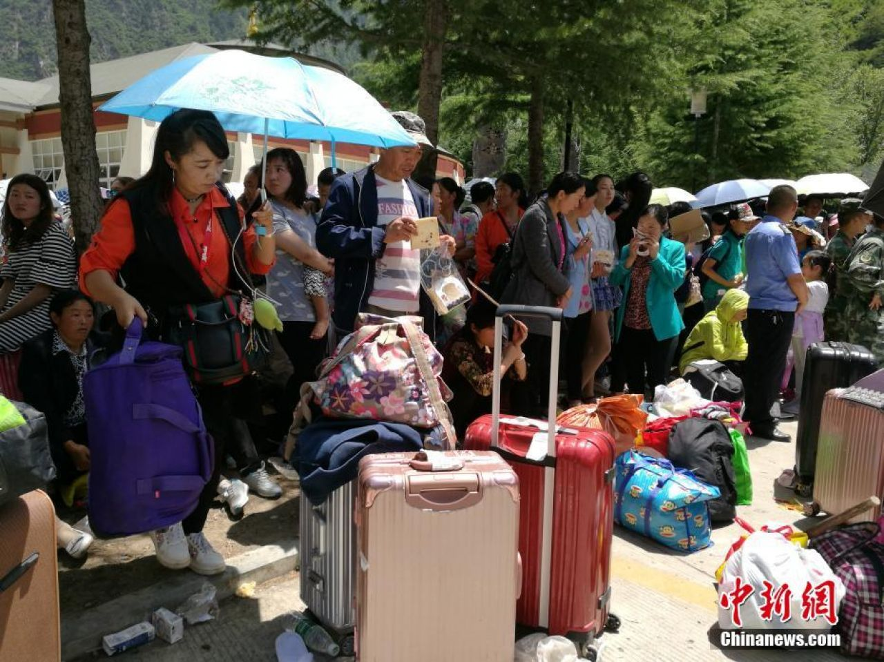 Tourists waiting to be transferred out of the disaster area.