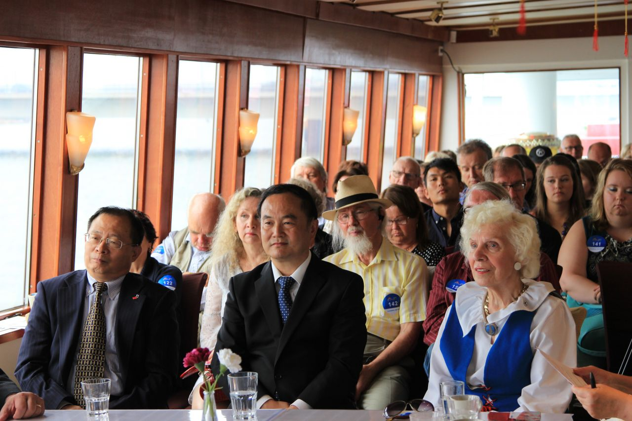 Dignitaries listen intently to the Beijing presentations.