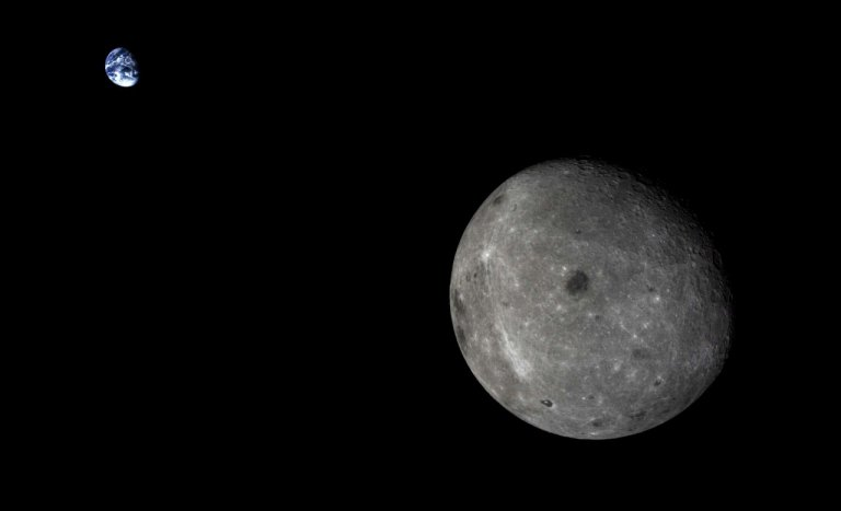 A view of the far side of the Moon and the distant Earth, captured by the service module for the 2014 Chang'e 5-T1 mission. (Photo: CAS)