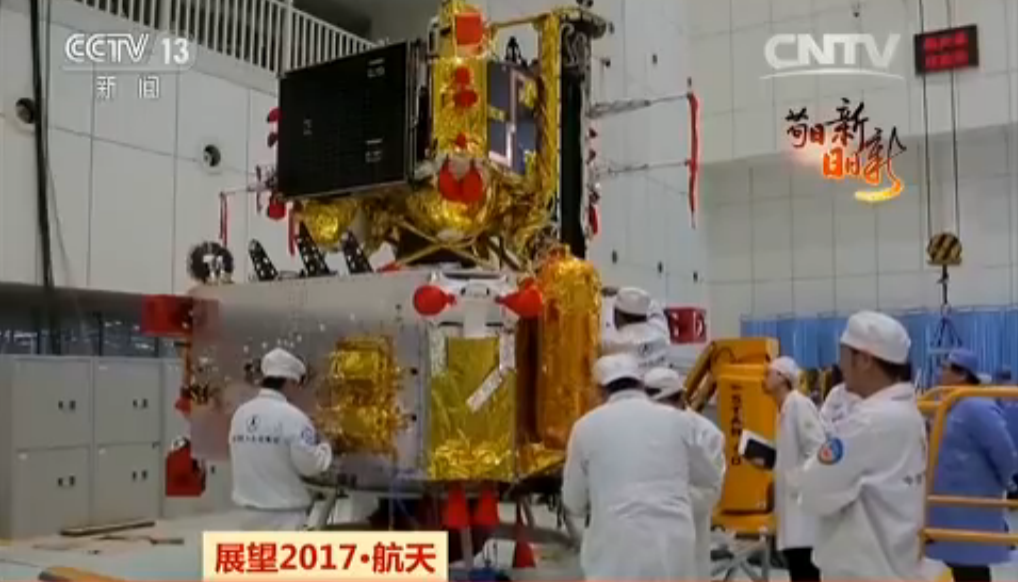 Scientists work on China's Chang'e-5 landing and ascent vehicles (Framegrab/CCTV).