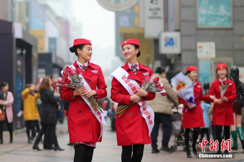 Air steward students at Chengdu East Star Airlines training college take to the streets to sell flowers and earn credits.