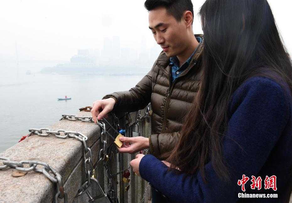 Couples in Chongqing engrave and attach locks to symbolise their love for each other.