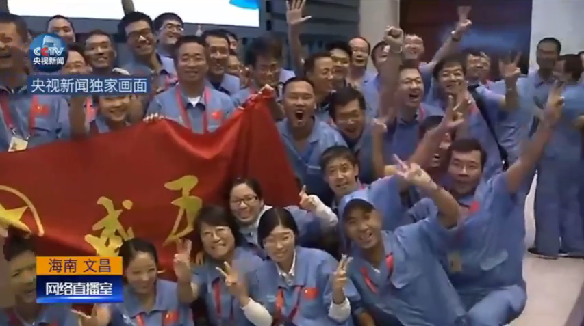Long March 5 team members celebrate the successful launch of Long March 5 and Shijian-17 (Framegrab/CCTV).