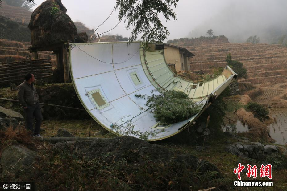 Fengyun-4A payload fairing comes to Earth in a paddy field in Jiangxi.
