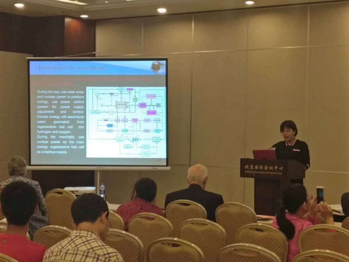 Prof. Guo Linli presents the lunar base conceptual design, which would be located on Sinus Iridum, at GLEX 2017 in Beijing.