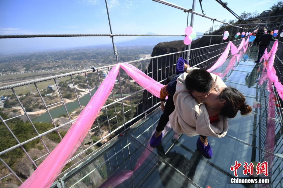 A high altitude kissing contest held on a huge glass bridge in Hunan Province.