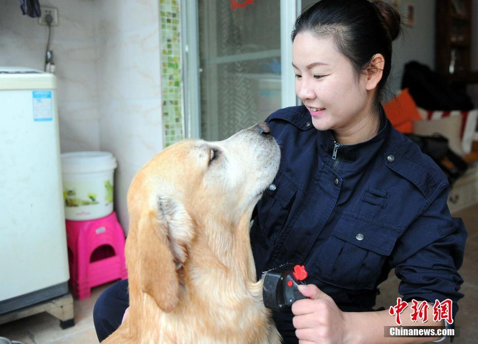 Puppy love: A Nanning police force task force instructor with her best friend.