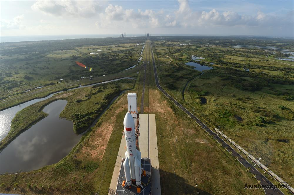 The first Long March 5 rocket being rolled out at Wenchang (Su Dong/China Daily)