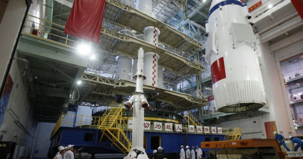 The Shenzhou-10 launch escape system and payload fairing ready for stacking on a Long March 2F rocket.