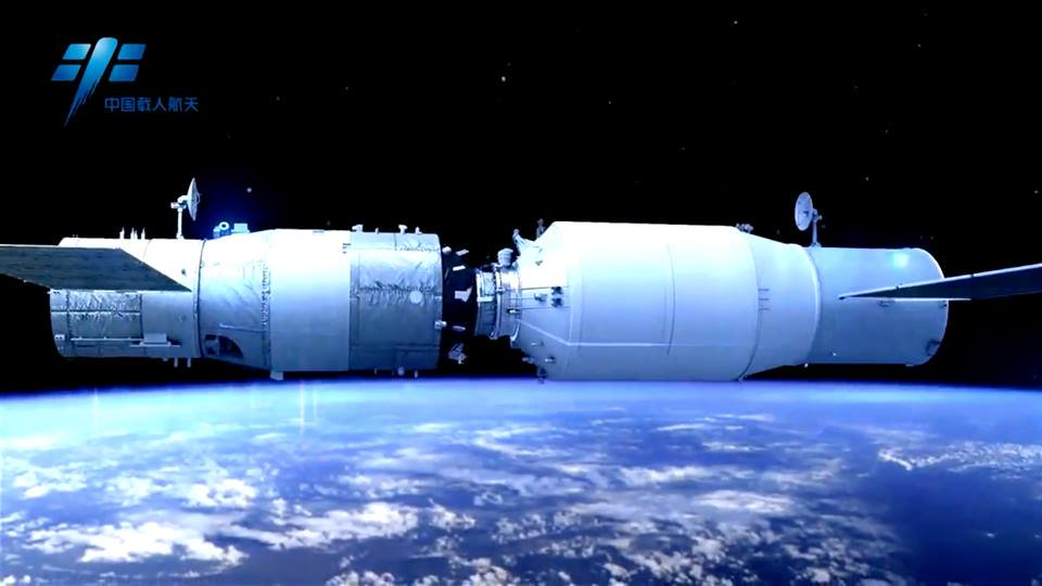 A rendering of Tiangong-2 (left) docked with Tianzhou-1 (CMSE).