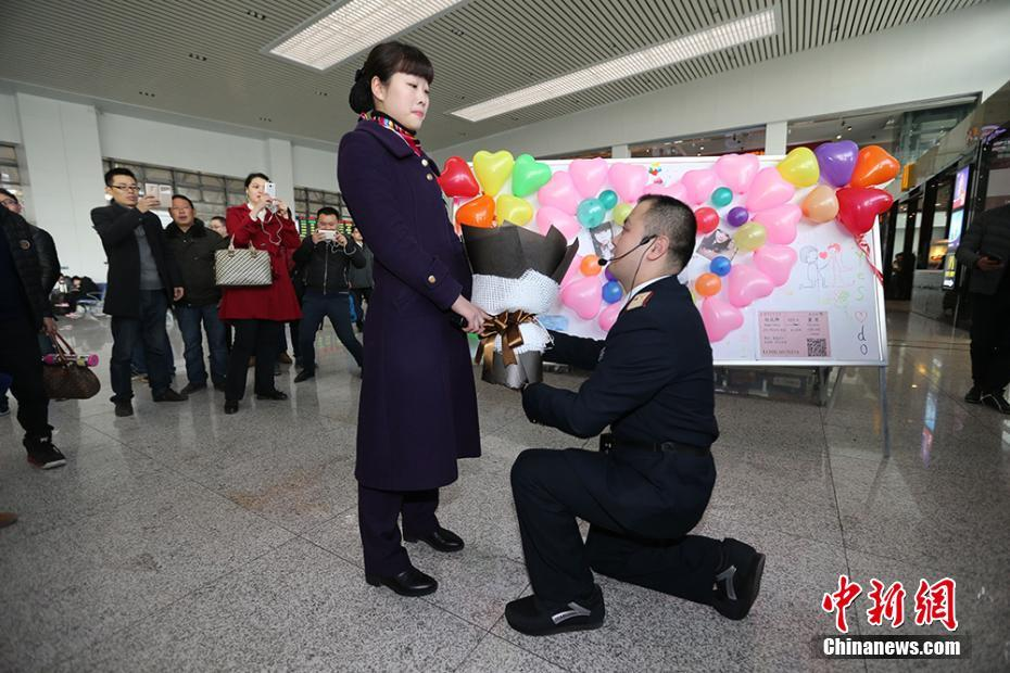 A proposal at Nanjing railway station. Don't worry, despite the expression she says yes.