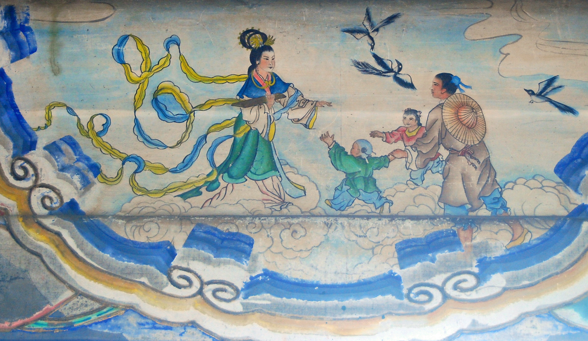 Star-crossed lovers Niulang and Zhinu are permitted to be together one day a year, during the Qixi Festival. The painting is in the Long Corridor of the Summer Palace in Beijing.