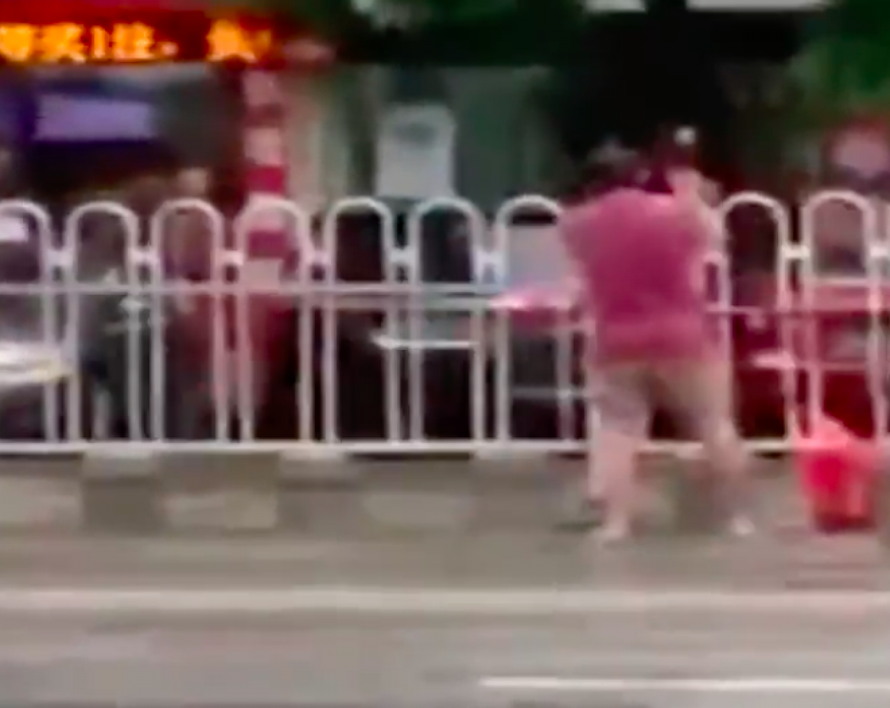 Man caught hacking through traffic barriers to create shortcut in Foshan, China