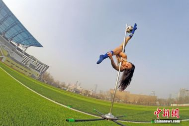 Pole dancers put on football-themed show