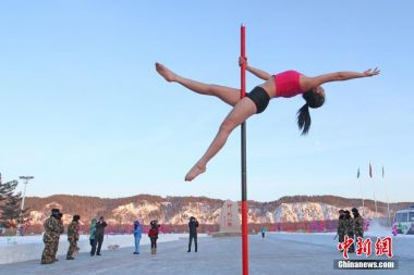Pole dance group brave the cold in Arctic Village