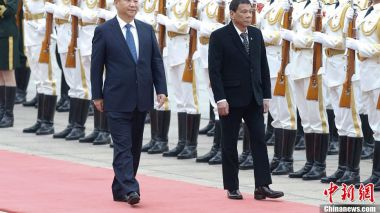 Leaders of China, Philippines vow to boost bilateral ties