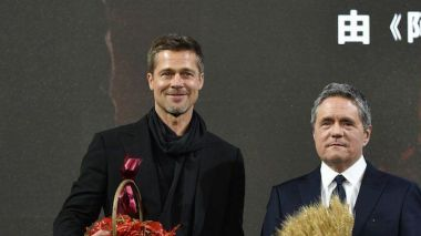 Brad Pitt receives strange chilli pepper gift at Chinese premiere