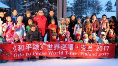 Chinese children sing for Santa at Christmas opening in Lapland