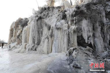 Massive frozen waterfall created by Chinese villagers