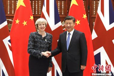 China welcomes Britain's May to visit at appropriate time