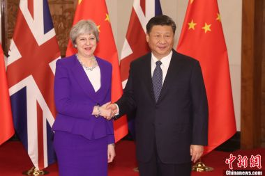 Xi Jinping meets Theresa May in Beijing to advance bilateral ties