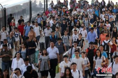 China's railway system to carry 647m passengers during 2018 summer travel rush