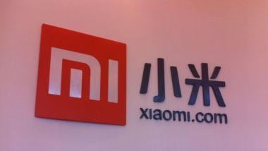 Xiaomi shares fall below IPO price during Hong Kong debut