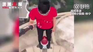 Chinese daredevil dies in 62-floor fall while filming his own death