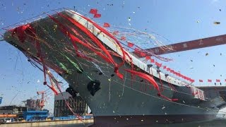 China's first domestic-built aircraft carrier may begin sea trials today