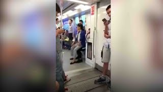 Elderly Chinese woman sits on man's lap after subway seat argument