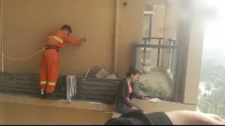 Chinese firefighter saves woman threatening to jump off ledge