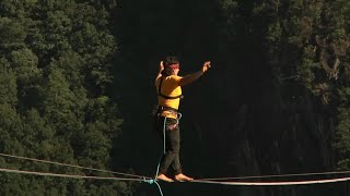 French athlete sets record for 'longest blindfold slackline walk' in China