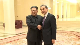 Kim Jong-un and Chinese FM leader discuss ties ahead of Trump meeting