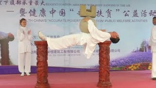 Chinese tai chi master sets record for bearing heaviest load while suspended