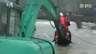 Excavator saves woman from East China flooding