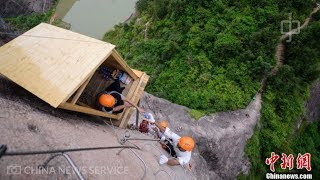 Convenience store? 100m-high cliffside shop opens to the public in China