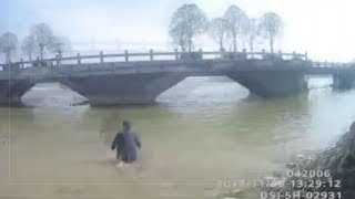 Drunk Chinese driver jumps into river to escape breathalyser test